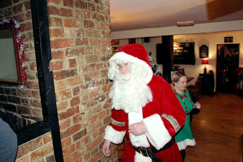 Santa walking through Restaurant